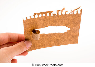 Piece of torn paper in hand