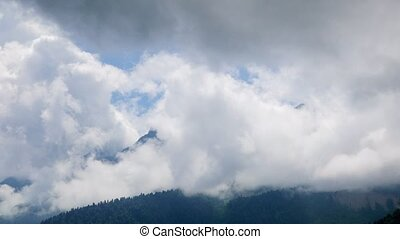 Clouds in the mountains. Time Lapse. Sochi, Russia. UltraHD...