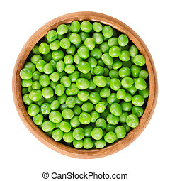 Raw peas in wooden bowl over white - Raw peas in wooden...