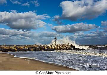 Wave Crashing on Jetty in Ocean - A wave crashing on a Jetty...