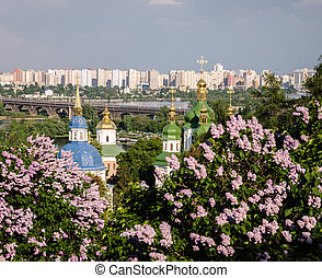 Church in the spring garden - Orthodox cross on a background...