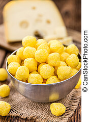 Portion of Cheese Balls (fried) on wooden background...