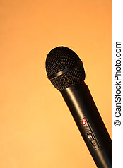 Black Modern Microphone - A modern black handheld ball head...
