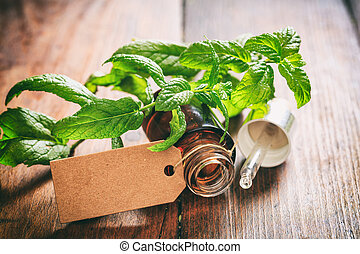 Fresh peppermint and oil on wooden background - Fresh...