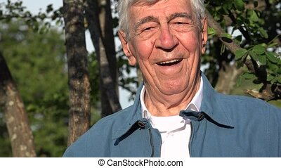 Smiling And Happy Old Man Senior Or Retiree