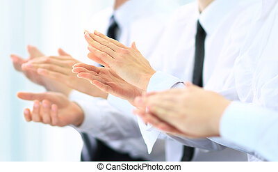 business group of people clapping hands during a meeting conference
