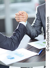 concept of a reliable partnership.the handshake business partners