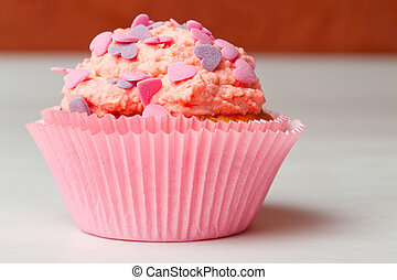 strawberry cupcake with icing sprinkles
