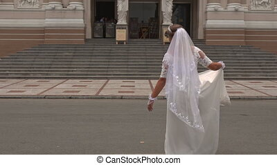 Bride in Long Dress Turns Around at Opera Theatre Entrance -...