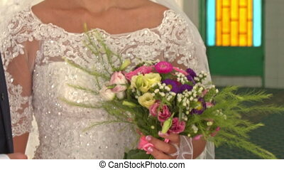 Caucasian Bride in Lacy White with Bouquet in Mosque in...