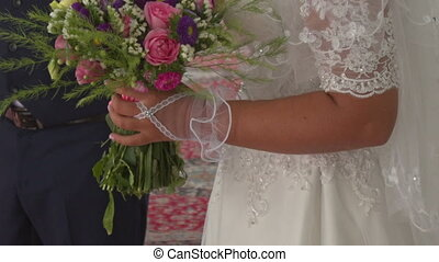 Closeup Bride in White Lacy Dress under Veil Smiles -...