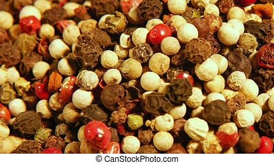 Mix of spices: red black white green hot pepper