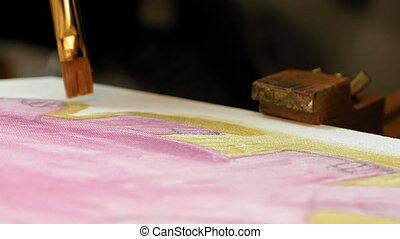 Artist paints picture artwork canvas in art studio - Artist...