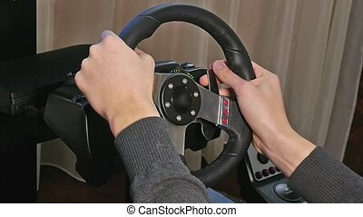 Young boy plays a virtual racing video game.