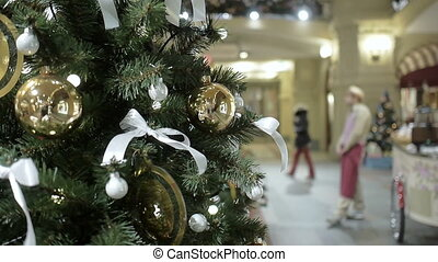New Year's and Christmas tree decoration in shopping mall -...