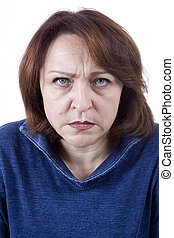 Senior woman with an angry expression on his face on a white...