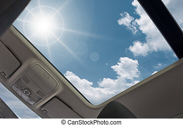 sunroof - Automotive sunroof open to sky.