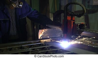 Cutting of metal. Sparks fly from plasma and metal...
