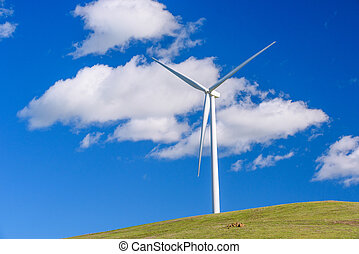 Wind turbine with 3 blades in a field of grass - A field...