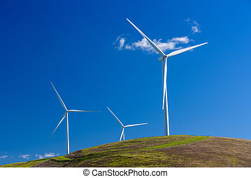 Wind turbine with 3 blades in a field of grass