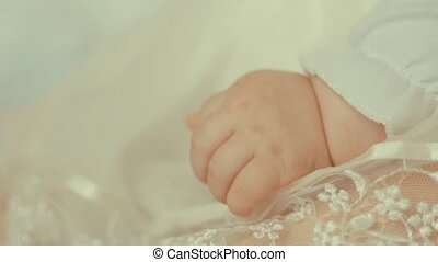 Little newborn child's hand.Close up shot with small depth of field