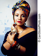 beauty bright african woman with creative make up, shawl on head