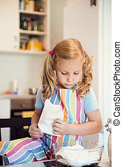 Cute little girl preparing Christmas sweets at home