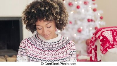 Attractive young woman in Christmas winter fashion relaxing...