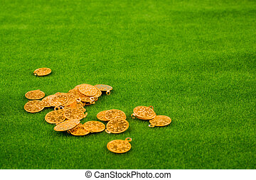 Fake gold coins on grass