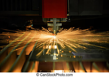 Cutting of metal. Sparks fly from laser - Cutting of sheet...