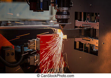 Cutting of sheet metal. Sparks fly from laser by automatic...