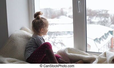 Young girl looking in the window