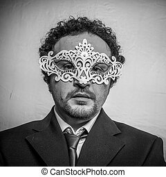 Spy, Sensual and mysterious businessman with white venetian mask