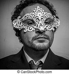 Secret, Sensual and mysterious businessman with white venetian mask