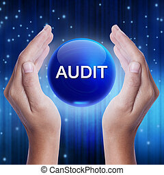 Hand showing blue crystal ball with audit word