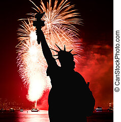 The Statue of Liberty and July 4th firework - The silhouette...