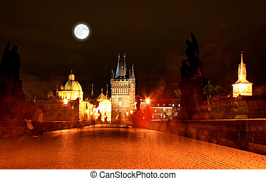 The magnificent Prague Castle at night along the River...