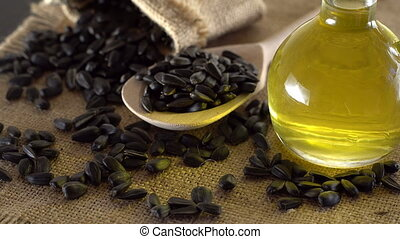 Sunflower seeds and oil close up.