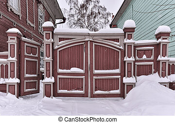 Wooden gate of a residential building of the last century in...