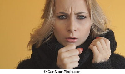 Sick young woman is coughing, close up.