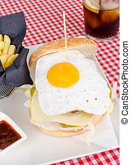 Burger with egg - Burger served with sunny sid oup eg and a...