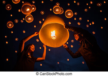 Thai people floating lamp in Yeepeng festival - sweetheart...