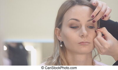 Beautiful young woman with eyelash extension. Woman eye with...