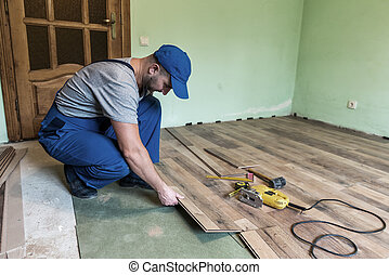 laminate - worker install the laminate floor
