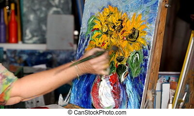 Process of oil painting, artist paints picture on canvas. Sunflowers.