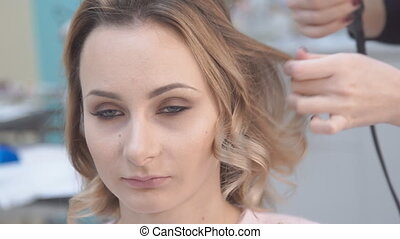 hairstyle,hairdresser's hands to work on client's hair at salon