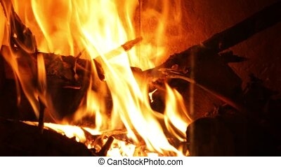Flames of a fireplace - Burning fire in a home fireplace
