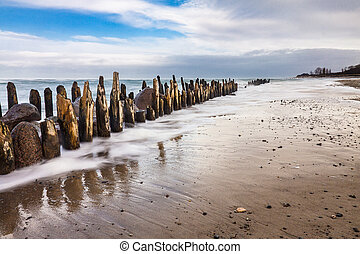 Groynes on shore of the Baltic Sea on a stormy day.