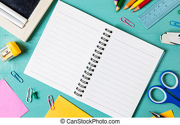 School supplies side border on a wood background. Stationery on a wood background. back to school, education concept