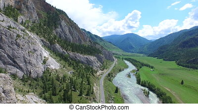 Aerial shot curvy road and forest, Altay